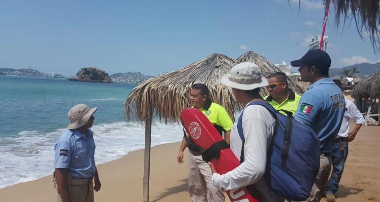 mar_fondo_acapulco_bandera_roja