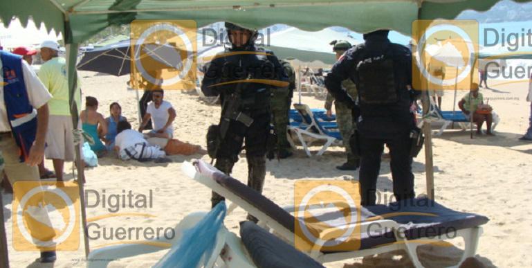 turista_infarto_playa_acapulco